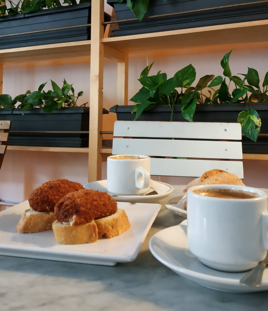croquetas on bread with coffee