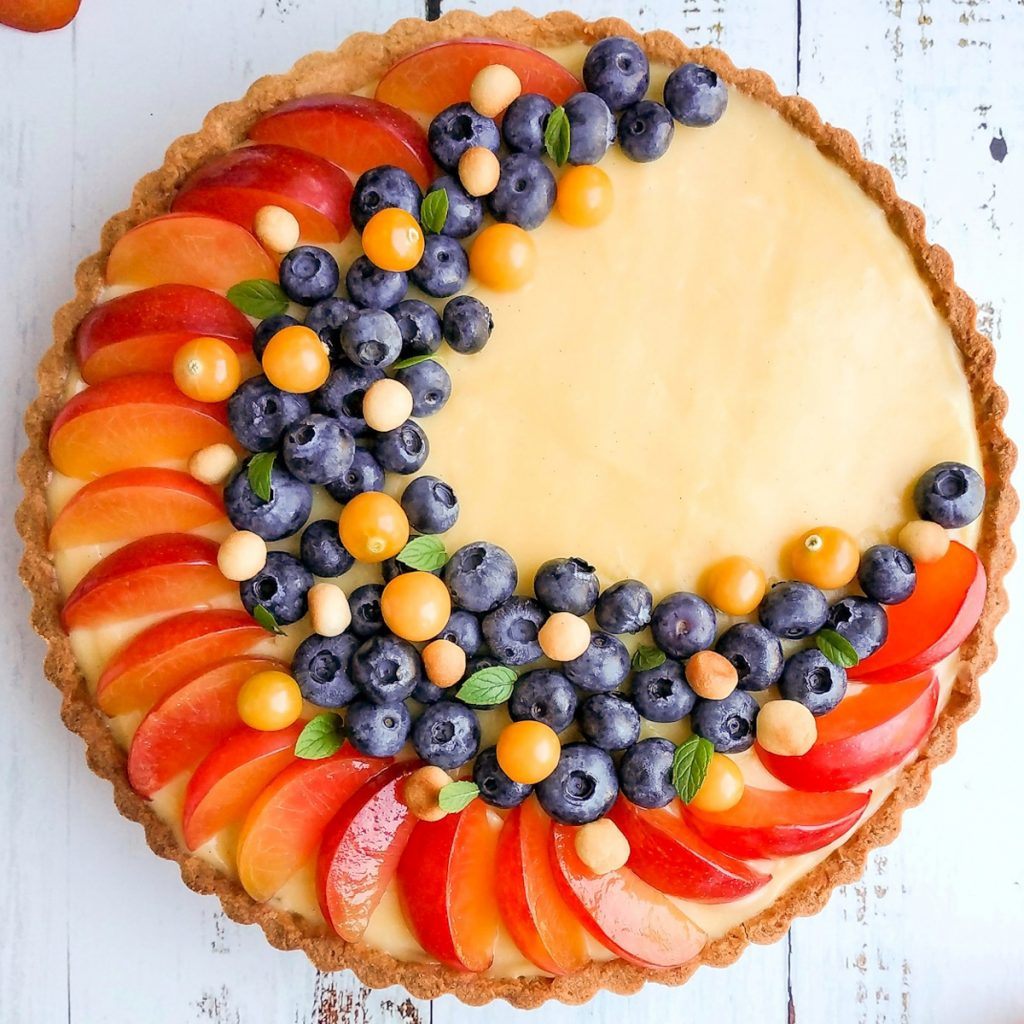 Pastry cream tart with plums and blueberries