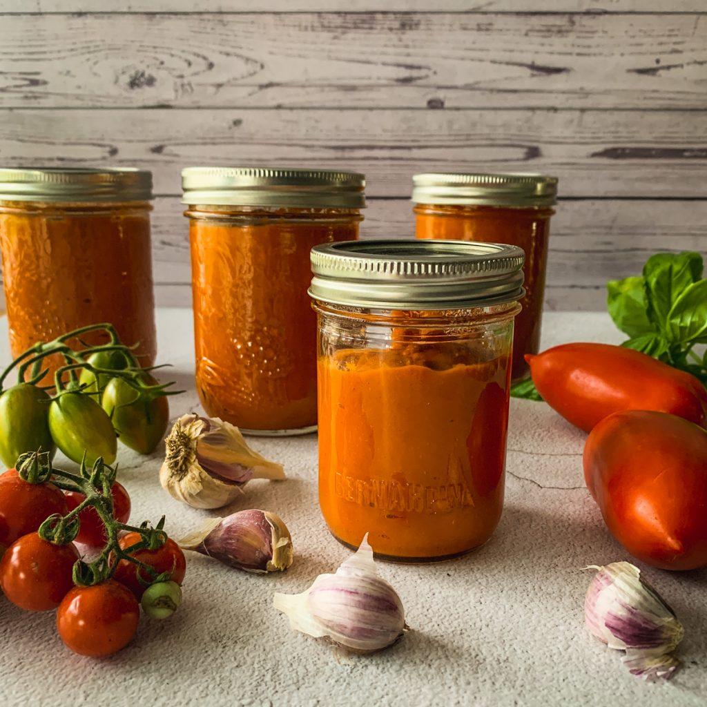 tomato sauce in mason jars.
