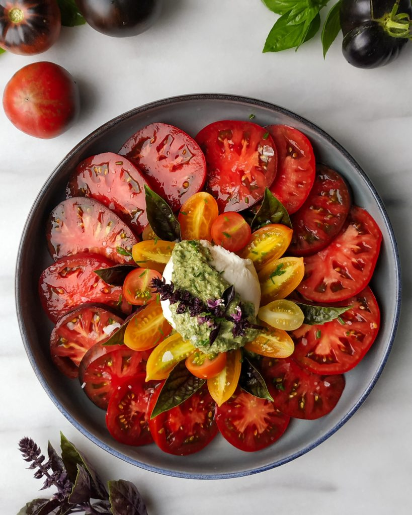 sliced tomatoes with ball of cheese in the middle.