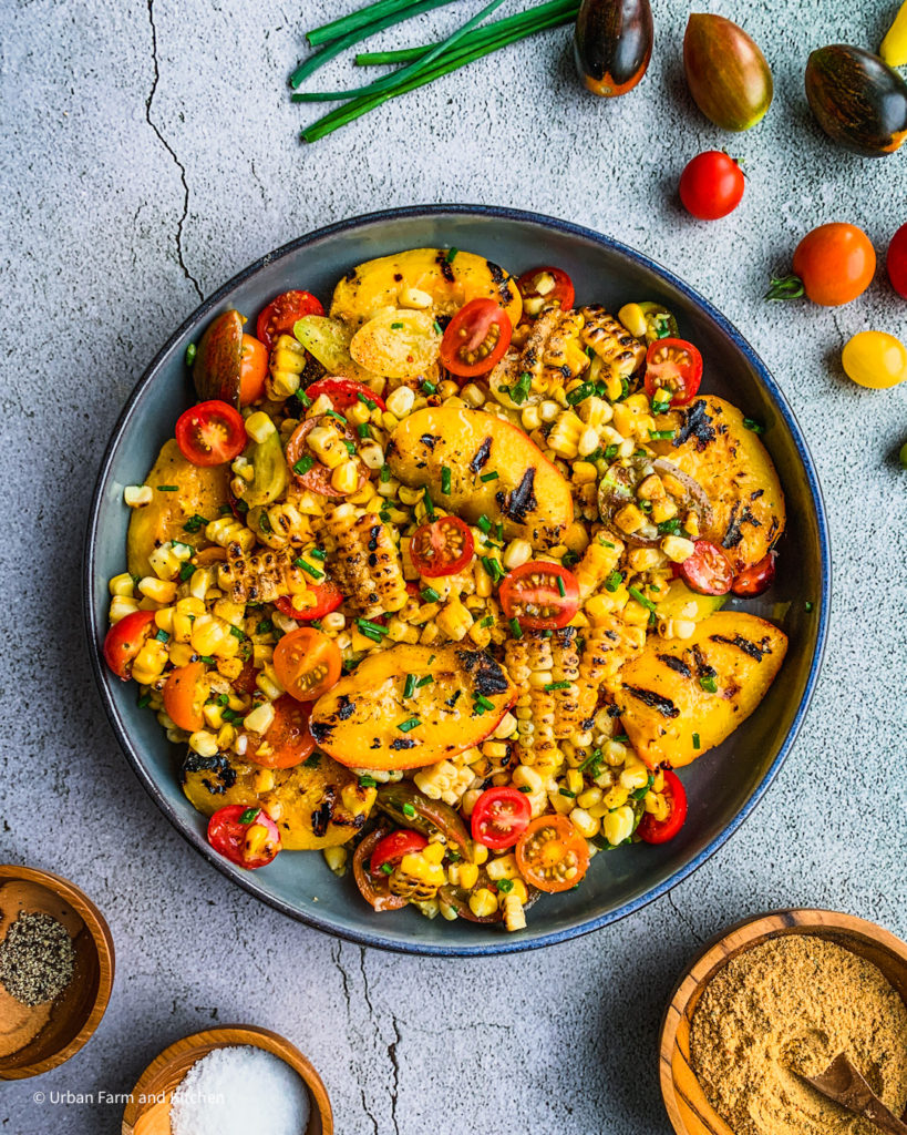 Gilled corn with grilled peaches and tomatoes.