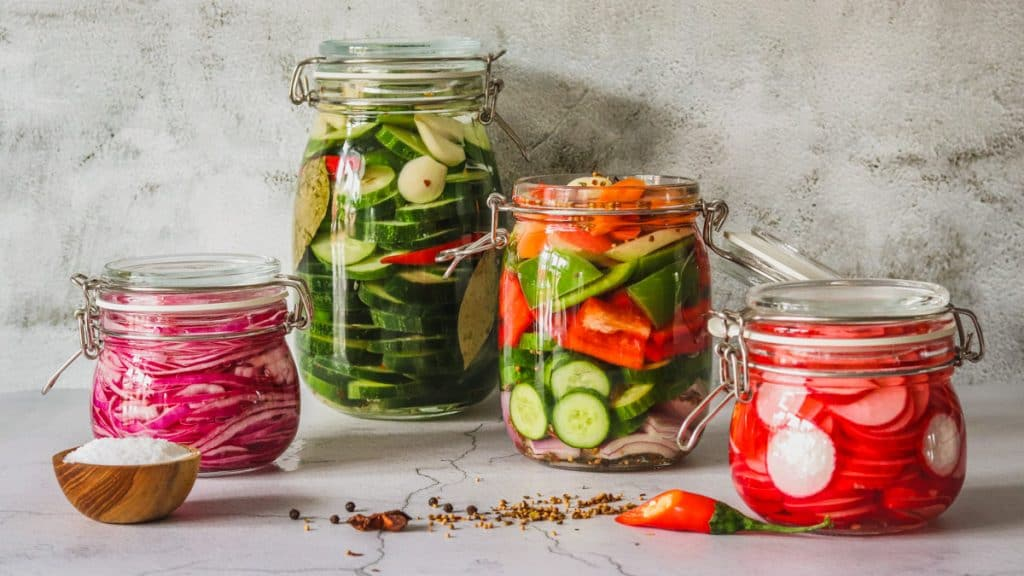 Mason jars with pickles vegetables