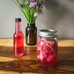 chive flowers steeping in vinegar