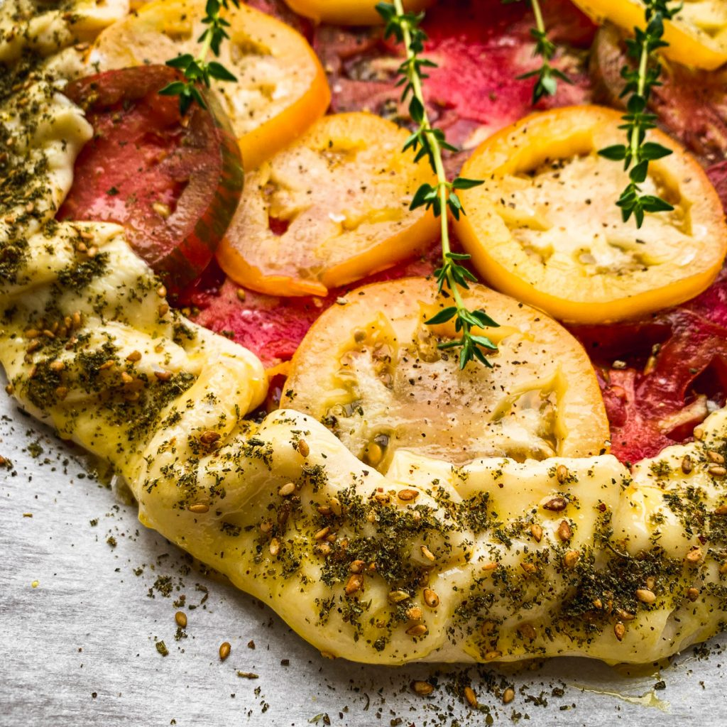 galette crust sprinkled with spices.