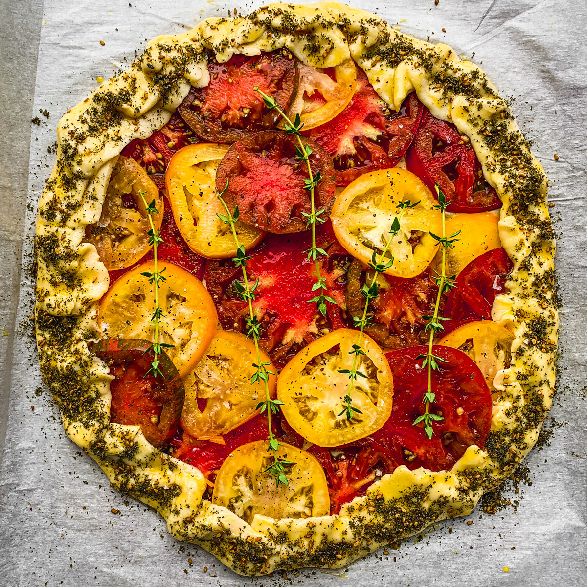 Tomato Galeette with za'atar and thyme garnish.