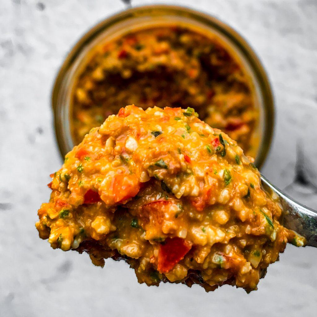 Sicilian pesto on spoon.