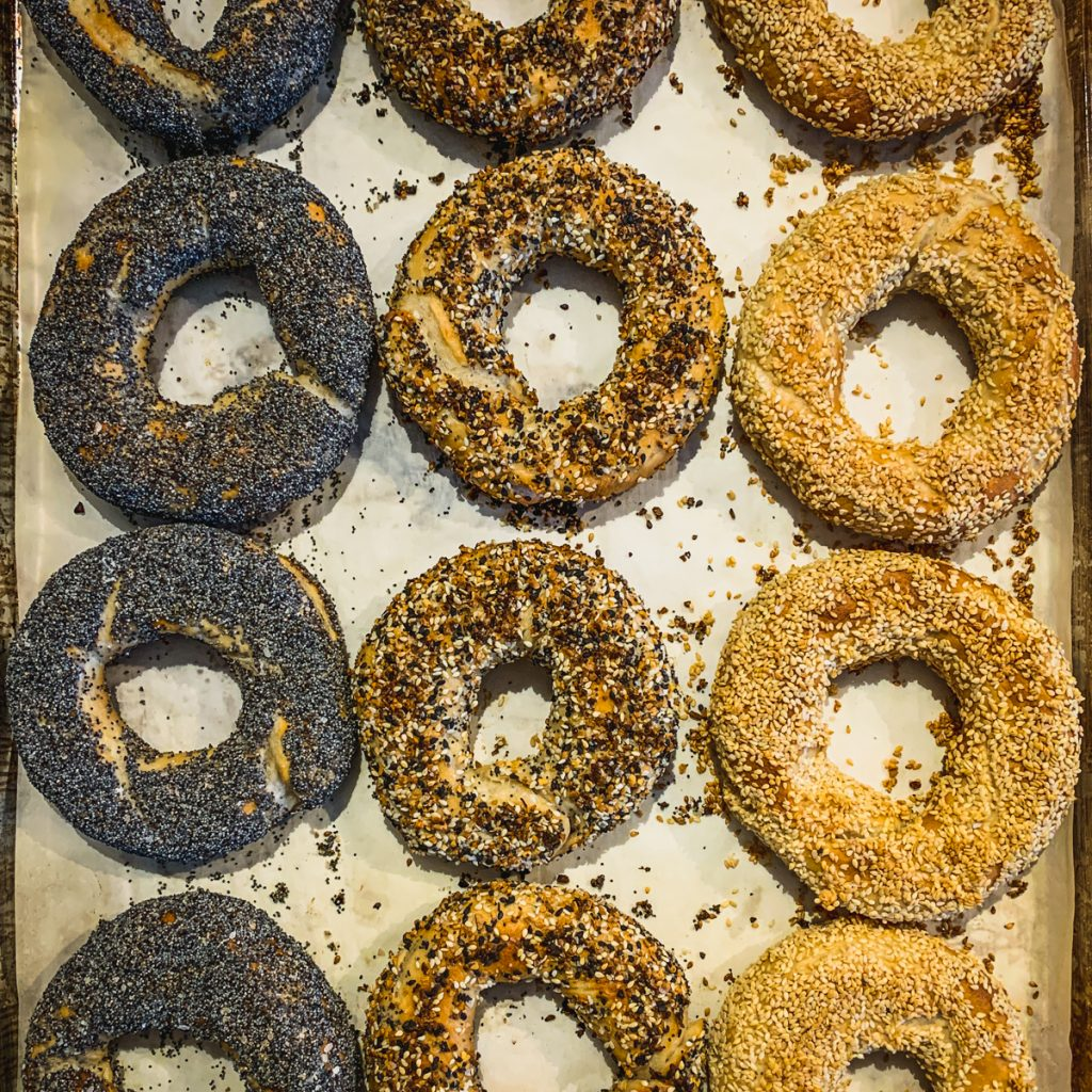 Cooked bagels with sesame and poppy seeds.